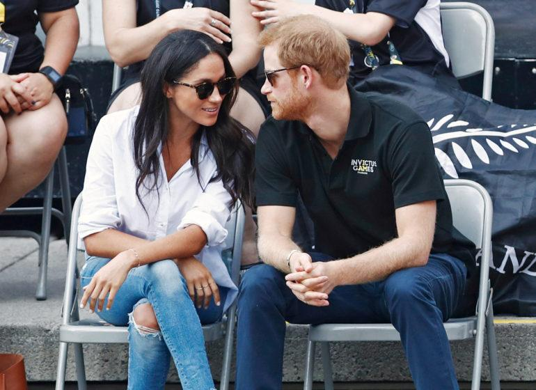 FILE PHOTO: Britain's Prince Harry arrives with girlfriend actress Meghan