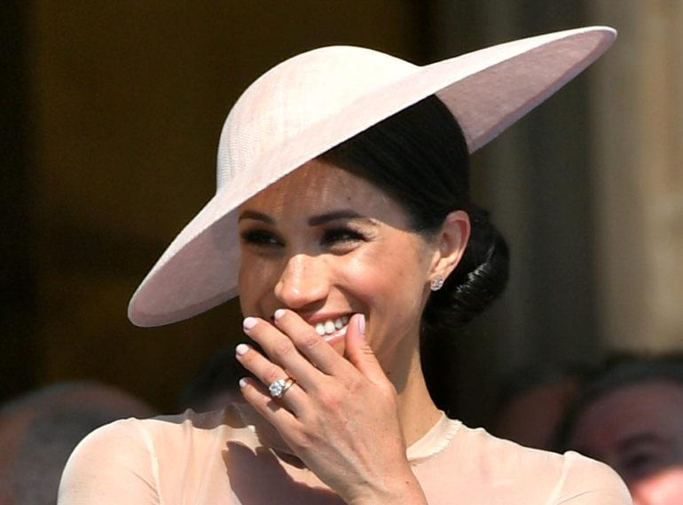 FILE PHOTO: Meghan, Duchess of Sussex attends a garden party