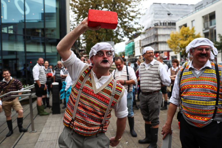 Monty Python fans dressed as the Gumbys gather in an